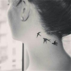 swallow tattoo on neck