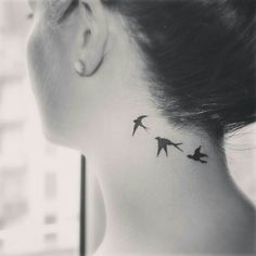 swallow tattoo on neck