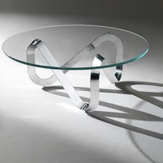 Contemporary Sculptural Glass Top with Metal base Coffee Table