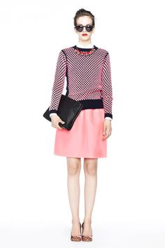 JCrew showing in pink in Our Collection wool-silk A-line skirt worn with the Etta studded-heel pumps.
