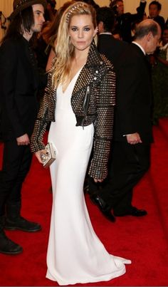 Sienna Miller wears a Burberry crêpe open-back plunging dress with crystal and stud embellishment and a studded cropped biker jacket at the Met Gala 2013 Sienna Miller, Ellie Saab, Dolce & Gabbana, Tom Ford, Versace, Marc Jacobs, Burberry Dress, Plunge Dress, Costume Institute