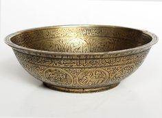 """Islamic Calligraphic """"Magic"""" Bowl  An Islamic calligraphic bowl with Koranic inscriptions and talismans, with a cone rising from the center. Water is placed in the bowl and when it comes in contact with the sacred inscriptions, it is capable of healing all illness"""