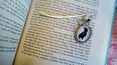 pitbull bookmark for pitbull mom gift for dog mom cameo dog bookmark for dog lover silver charm bookmark with dog paw birthday gift for mom   This is the perfect gift for the book or pet lover! Pretty bronze bookmark with vintage style photo of a Pitbull. Paw print charm and genuine baroque pearl dangles along the spine of your book while the bronze bar holds your page until you return. Comes with a genuine baroque pearl bead. You can choose a colorful glass bead instead (birthstone…