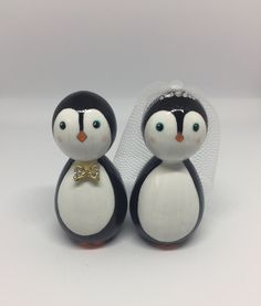Little penguin bride and groom peg dolls. Perfect alternative for a winter wedding. Cake toppers by Gabe & Penny available on Etsy or Facebook from £22