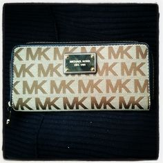 Authentic Michael Kors Tan Jet Set Zip Wallet - $125.00