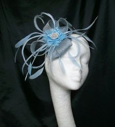 Pale Blue Venus Feather Fascinator Mini Hat, Order Now from www.indigodaisyweddings.co.uk Specialising in stunning bespoke cocktail fascinators and formal hats in a wide range of colours, perfect for Royal Ascot and The Kentucky Derby. Plus all your wedding floral accessories including shoe clips, vintage flapper bands, feather and flower fascinators, feather fans, fairy wands, wrist corsages, wedding bouquets & buttonholes. Worldwide Delivery.