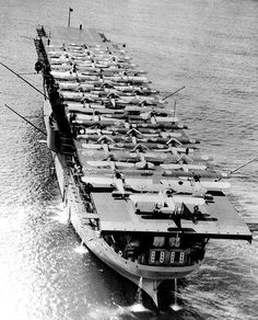On 20 March 1922 the fuel ship USS Jupiter was recommissioned as USS Langley (CV 1), the U.S. Navy's first aircraft carrier. This photo shows Langley at Pearl Harbor, Oahu, Hawaiian Islands, with 34 planes on her flight deck, May 1928. National Archives photo 80-G-424475.