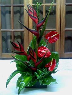 Fire Red Heliconias, Red Anthuriums, potus leaves and masengana leaves.