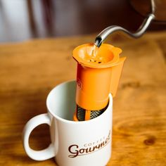 The Coffee Gourmet uses a constant flow of near-boiling water to help the coffee grinds bl...