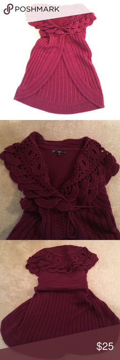 Knit sweater vest Burgundy knit sweater vest, can be paired with leggings or jeans, with a mock or turtle neck long sleeves...and a tall boot, never worn Sweaters Shrugs & Ponchos