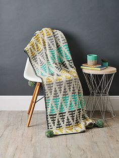 Gaze over a Nordic woodland from your favourite chair with Esme Crick's modern mosaic throw. Channel Scandinavian chic with this treetop-inspired geometric aesthetic. Mustard and turquoise add pep to. Easy Crochet Blanket, Crochet Blanket Patterns, Crochet Blankets, Crochet Stitches, Simply Crochet, Double Crochet, Manta Crochet, Crochet Mandala, Crochet Lace