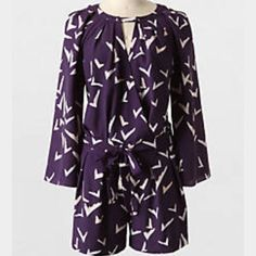 Stylish purple romper from Anthropologie Very chic purple romper with modern pattern. Wrap style with a waist cinching sash. Sleeves are large and flowy. 100% polyester. Leifsdotter, Anthropologie brand! Anthropologie Other