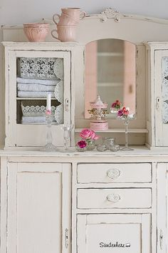 "Antique cabinet, unfortunately painted over to look ""shabby chic""--gag. Underneath, there is real beauty."