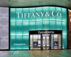 The two-story façade is lit with Tiffany Blue and carved with a wheatleaf pattern similar to that which frames the entrance of Tiffany's Fifth Avenue flagship store in New York City Tiffany E Co, Tiffany Store, Tiffany Blue Weddings, Azul Tiffany, High Street Shops, Beauty Salon Decor, Second Story, Event Design, Entrance