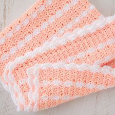 """""""Peaches & Cream"""" Crochet Baby Blanket Pattern Here's a tutorial to make this adorably snuggly soft crochet baby blanket. It's a beautiful pattern that features pretty stripes and finished with a scallop edged trim. Materials Medium Weight Yarn in two colors: Creamsicle and White; and Crochet Hook Size H. Blanket Body Starting with Peach Yarn, Ch 138. …"""
