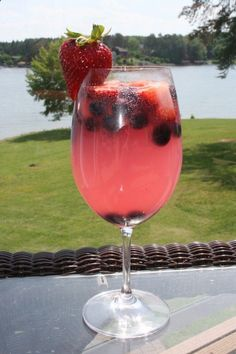 Blueberry-Strawberry Lemonade Sangria 1 cup frozen blueberries  cup fresh strawberries 1 (12 oz.) can of frozen pink lemonade concentrate 1 (750-ml) Chardonnay 3 cups lemon-lime soda Place all ingredients in a large pitcher, mix and serve in chilled glasses.