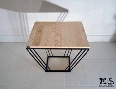 MAUDELINE COFFEE TABLE The frame of the table is painted mat black. This hand made coffee table is made of ash wood and varnished.Fits every home and bussiness space. MAudeline, Kraina ES; www.krainaes.pl #coffeetable, #smalltable, #woodtable, #metaltable, #irontable, #minimalism, #table, #designstyle, #minimal, #krainaes, #handcraft, #craft, #stolik, #stolikkawowy, #minimalizm, #minimal, #ręczniewykonany