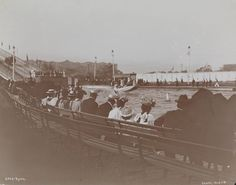 Gilded Age observers watching, Shute the Chute amusement ride, in Sea Lion Park - Coney Island, NY. c.1895