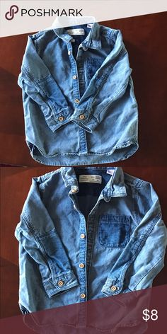 Zara Baby denim wash toddler boy shirt Excellent worn condition- the natural light and my camera is not showing the true color. It appears light colored however it is traditional color denim. The size is 18-24 but because I put it in the dryer I shrunk it so it can fit a 12-18mnth. Zara Shirts & Tops Button Down Shirts