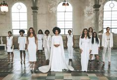 Solange Knowles poses with her bridal party in a gorgeous white cape gown // Photo by Rog Walker