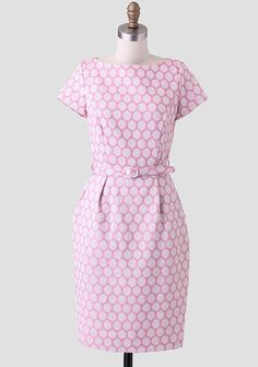 Accented with a matching optional belt, this fitted pink dress features an embroidered circle design throughout. Perfected with side pockets and pleating at the waist for added interest, this fli...