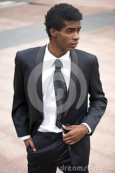 Portrait of a handsome african american fashion model in black suit by ...