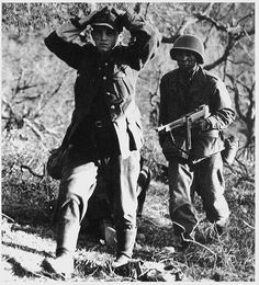 A Buffalo Soldier, wielding a Thompson machine gun, brings a captured German Soldier to the rear in Italy. Battle Of Monte Cassino, Ww1 Soldiers, Prisoners Of War, Historical Pictures, World History, Black Tank, Armed Forces, World War Two, Black Panther
