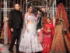 As the Aamby Valley India Bridal Couture Week comes to an end, we look back at some of the most stunning pieces on the ramp. Modern brides, bookmark Jyotsna Tiwari's patchwork lehengas and Adarsh Gill's minimalistic fuchsia saris. For traditional brides, Tarun Tahiliani's opulent creations would make for an ideal choice. We're however leaning towards Suneet Verma's warrior princess - laden with armlets of gold. As for the groom, there's nothing quite as ...