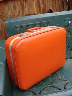 I actually still have this same suitcase from when I was a kid. :)    Vintage 1960s Tangerine Orange Small Suitcase @ thecherrychic.etsy.com