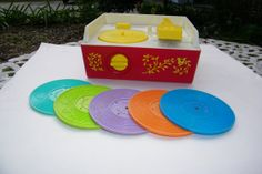 1971 Vintage Fisher-Price Record Player with 5  Records:  Record 1: (purple) plays Humpty Dumpty & Jack and Jill  2: (lime green) plays Twinkle, Twinkle, Little Star & Au Clair De La Lune  3: (dark blue) plays Oh Where, has my Little Dog gone? & London Bridge  4: (orange) plays Camptown Races & Children's Marching Song  5: (sea foam green) plays Edelweiss & Hickory Dickory Dock   Just wind up the knob in the front; switch on the top button and delightful music plays.