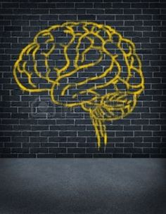 brain: Criminal mind with a sprayed graffiti painting of a human brain on an old outdoor street brick wall as a health care and legal symbol of criminal behavior and problems in social behavior