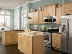 This is my fav. Light cabinets, dark counter tops, dark flooring. Switch up the toppers for dark moldings and have all black appliances. Done. And of course robin's egg blue walls.