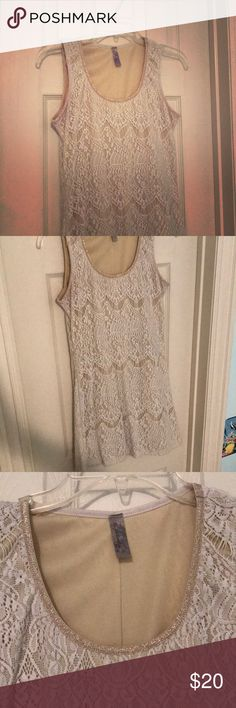 Beautiful Lace Dress Size: M Lace nude and white bodycon-like dress with gold detailing, but not too tight! Forms with body but has a bit of an A-line bottom. Dresses Mini