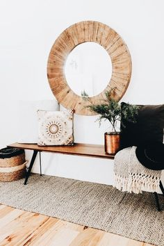 25 Cool Ideas For A Boho Chic Entryway a simple boho entryway with a wooden bench, a woven rug, a basket, a wood clad mirror and pillows Boho Chic Entryway, Rustic Farmhouse Entryway, Entryway Decor, Entryway Ideas, Modern Entryway, Entryway Lighting, Hallway Ideas, Entryway Mirror, Apartment Entryway