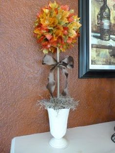 Fall topiary craft.   This would be easy to do and probably be cute with all different kinds of materials like silk flowers, maybe even grapes???? Oh, I'm getting a vision!