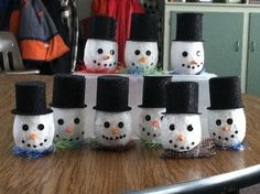Winter Votive Holders ~ We bought votives and added the tissue paper & glitter with the glue. The carrot nose is a rolled orange foam quarter circle. The hats are black glitter foam that was hot glued together. We added scarves from fuzzy yarn or wool scraps by hot gluing them to the bottom of the votive. Then added an electric votive.