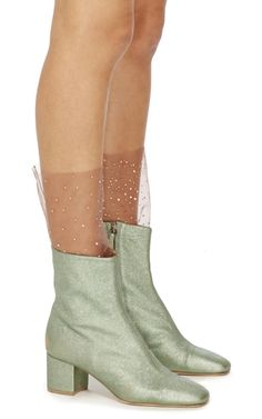 These **Brother Vellies** socks are rendered in coral tulle and feature Swarovski crystal embellishments