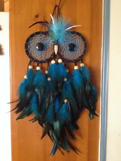 Owl made out of Dreamcatchers with blue feathers