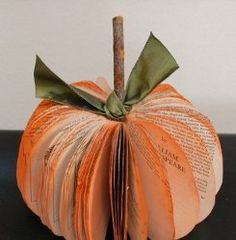 Have an old book you're not using anymore? Learn how to turn the pages into one of the coolest Halloween decorations around!