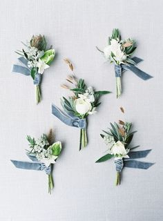 Ice blue, cool grey & white winter buttonholes  Photography: sarah hannam