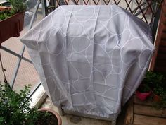 How to turn a $7.00 polyester shower curtain into a cool custom water resistant BBQ cover.