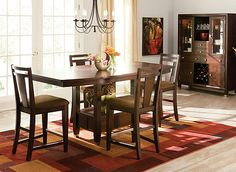 Make your dining room or kitchen an elegant and welcoming place to gather with this Northern Lights 5-piece counter-height dining set. Its exquisite walnut veneers over hardwood solids are enriched by a dark walnut-brown finish that will warm your room with its heirloom quality. And don't worry about disaster control during those big family dinners and holidays. This dining set's attractive counter stools are upholstered in comfortable, easy-to-clean microfiber, so cleaning up spills is a .....