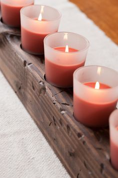 Create this beautiful DIY wooden candle centerpiece for the holidays from a fence post - it's easier than you think!