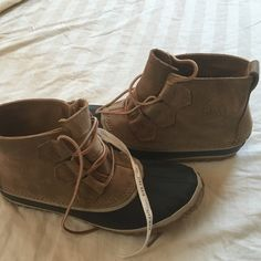 Authentic Sorel boots (snow or winter). Authentic Hand crafted Sorel Boots Natural Rubber boots. Bought from Madewell Store NYC. Never worn but after bought them notice a surface scratch on side (see pic) store person told me it's the style-but up to u. Ask questions before purchase. Rubber on shoe front is a navy color. Lace up. SOREL Shoes