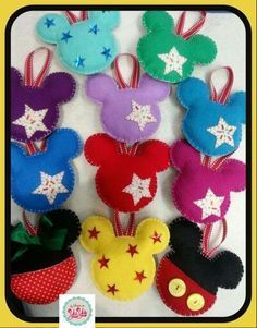 Mickey & Minnie mouse ornaments for Christmas (cut out felt into Mickey shapes, stitch together, add filler and ribbon)