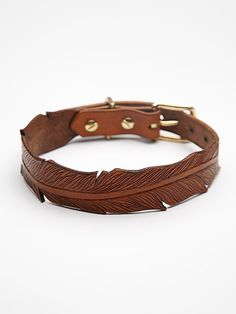 Finely Tooled Tooled Feather Collar at Free People Clothing Boutique