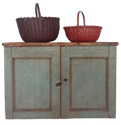 A181 Early 19th century New England Hanging Cupboard with original blue paint. Dovetailed case