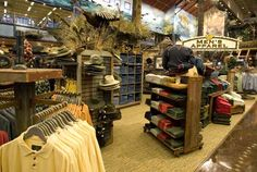 Store Image - 10. Bass Pro Shops. Visual merchandising. Retail display. Men's clothing and accessories.