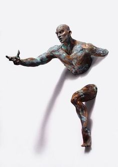 "Italian artist Matteo Pugliese's on going series of bronze sculptures, ""Extra Moenia,"" feature figures pushing, pulling, and emerging fr..."