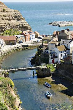 Staithes is a seaside village in North Yorkshire, England. Roxby Beck, a stream running through Staithes, is the border between the Borough of Scarborough and Redcar and Cleveland. Formerly one of the largest and most productive fishing centres in England, Staithes is now largely a tourist destination.